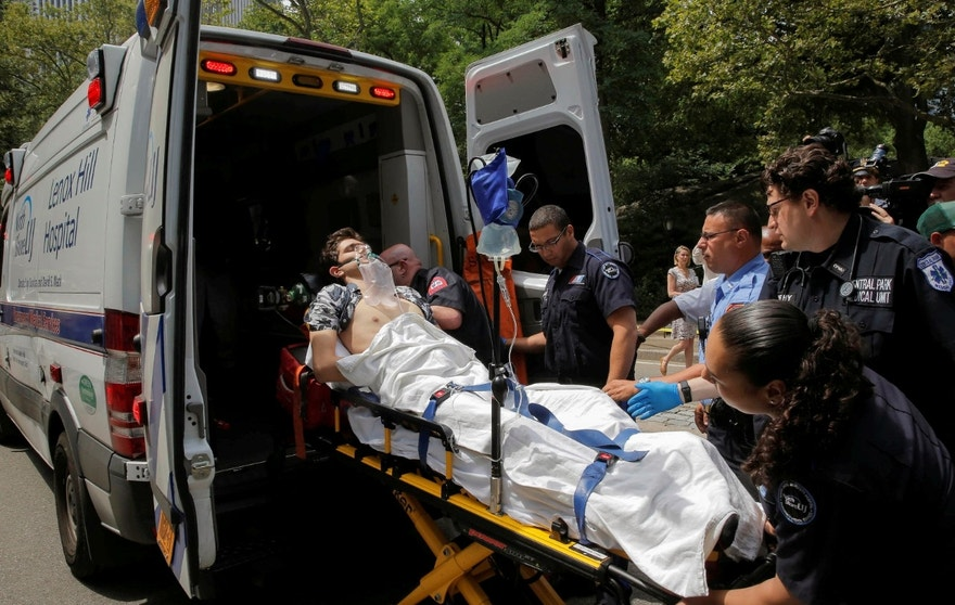 A man is loaded into an ambulance after he was injured after an explosion in Central Park, in Manhattan, New York, U.S. on July 3, 2016.  REUTERS/Andrew Kelly - RTX2JI84