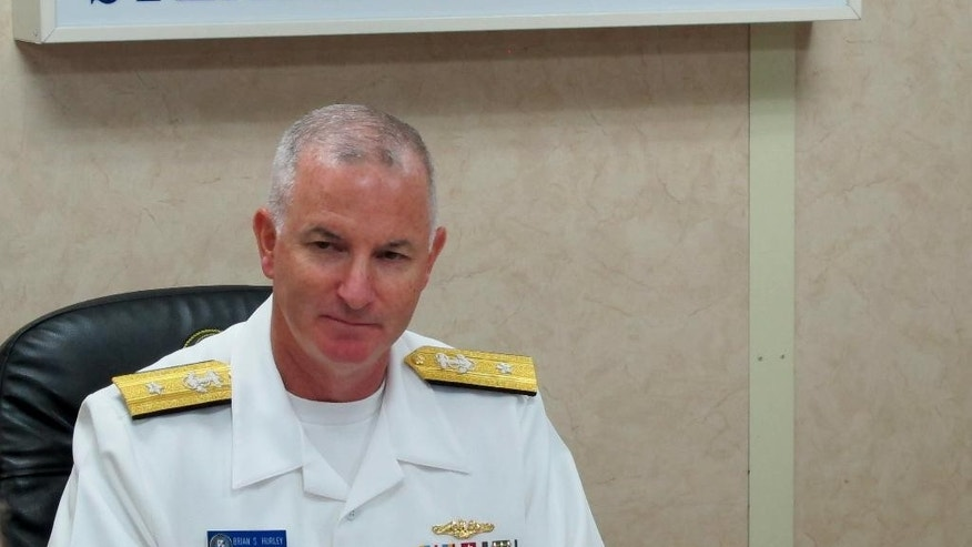 Rear Admiral Brian Hurley, the commander of the US 7th Fleet Task force 73, talks to a select group of reporters on board the US Navy hospital ship USNS Mercy off the waters of Legazpi city in central Philippines Monday, July 4, 2016. Rear Admiral Hurley said the U.S. military is concerned about a series of attacks and abductions of tugboat crewmen by Abu Sayyaf extremists in Southeast Asian waters and is willing to lend a hand if needed as part of America's aim to ensure the freedom and safety of navigation in the region. (AP Photo/Jim Gomez)