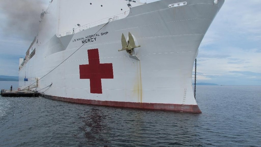 The US Navy hospital ship USNS Mercy is docked off the waters of Legazpi city in central Philippines for a medical mission Monday, July 4, 2016. Rear Admiral Brian Hurley, the commander of the US 7th Fleet Task force 73, in an interview with a select group of reporters on board the US Navy hospital ship USNS Mercy said the U.S. military is concerned about a series of attacks and abductions of tugboat crewmen by Abu Sayyaf extremists in Southeast Asian waters and is willing to lend a hand if needed as part of America's aim to ensure the freedom and safety of navigation in the region. (AP Photo/Jim Gomez)