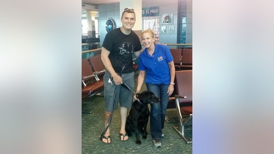 This June 30, 2016, photo provided by Molli Oliver, shows Oliver, a flight attendant with United Airlines, posing with Army Staff Sgt. Derrek Green and black lab, Zeva, after reuniting the two in El Paso, Texas. Green trained with Zeva two years ago before he was assigned to a combat engineering unit and had to leave the dog behind. Zeva stayed in kennels in Fort Leonard Wood, Mo., until Green was able to adopt her. It is the fifth time Oliver has helped reunite a retired military dog with its former handler. (Molli Oliver via AP)