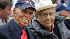 FILE - In this Nov. 11, 2015 file photo, Tuskegee Airmen Roscoe Brown Jr., left, and Norman Lear pose for a picture before the annual Veteran's Day parade in New York. Brown, who served with the all-black Tuskegee Airmen during World War II and was a longtime New York City educator, died Saturday, July 3, 2016, at a hospital in the Bronx. He was 94.  (AP Photo/Seth Wenig, File)