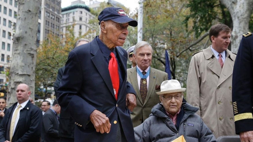 Tuskegee Airman Roscoe Brown Jr., second from left, participates in the annual Veteran's Day parade in New York in 2015.