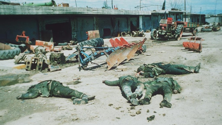FILE - In this March 31, 1988 file photo, bodies of Iranian Baseeje volunteer soldiers, are seen near the town of Halabja, Iraq. Iran claimed to have captured territory in northeast Iraq, in league with Kurdish separatists, and says that the alleged Iraqi chemical bomb attack on Halabja was aimed to halt the Iranian and Kurdish advance. Donald Trump gives credit where credit isn't due when he brands Saddam Hussein a potent foil of terrorists. Iraq's dictator was responsible for gassing thousands of Kurdish civilians, using chemical weapons against Iran, invading Kuwait, crushing political dissent and giving money to the families of Palestinian suicide bombers who terrorized Israelis. (AP Photo/Greg English, File)