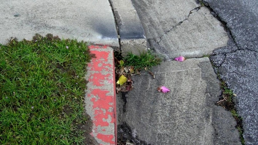 This March 10, 2006, photo provided by Andrew Alden shows an offset of a faulty curb that illustrated the seismic forces at work underneath a San Francisco Bay Area neighborhood in Hayward, Calif. The curb was fixed last month, stunning scientists, who say the curbside laboratory used for studying earthquakes was destroyed. Since at least the 1970s, scientists have painstakingly photographed the curb as the Hayward fault pushed it farther and farther out of alignment. (Andrew Alden/oaklandgeology.wordpress.com via AP)