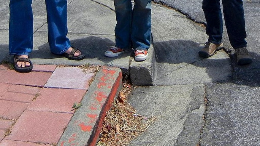 This May 28, 2012, photo provided by Andrew Alden shows an offset of a faulty curb that illustrated the seismic forces at work underneath a San Francisco Bay Area neighborhood in Hayward, Calif. The curb was fixed last month, stunning scientists, who say the curbside laboratory used for studying earthquakes was destroyed. Since at least the 1970s, scientists have painstakingly photographed the curb as the Hayward fault pushed it farther and farther out of alignment. (Andrew Alden/oaklandgeology.wordpress.com via AP)