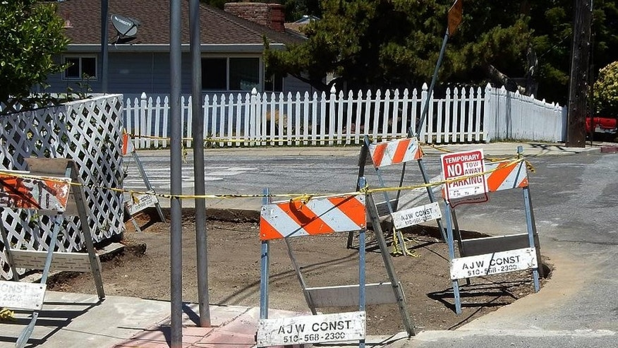 This June 24, 2016, photo provided by Andrew Alden shows a repair to a curb in a San Francisco Bay Area neighborhood in Hayward, Calif. The fix to the curb stunned scientists, who say the curbside laboratory used for studying earthquakes was destroyed. Since at least the 1970s, scientists have painstakingly photographed the curb as the Hayward fault pushed it farther and farther out of alignment. (Andrew Alden/oaklandgeology.wordpress.com via AP)