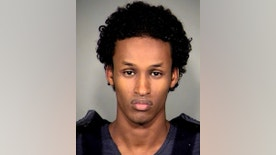 FILE -This Nov. 27, 2010, file photo provided by the Multnomah County Sheriff's Office shows Mohamed Mohamud. Convicted of trying to detonate a bomb at a tree-lighting ceremony in Portland, Ore., Nov. 26, 2010, Mohamud is seeking a new trial. An Appeals Court will hear oral arguments in Portland, Ore., Wednesday, July 6, 2016, one argument which is a challenge to warrantless surveillance. (AP Photo/Multnomah County Sheriff's Office, File)