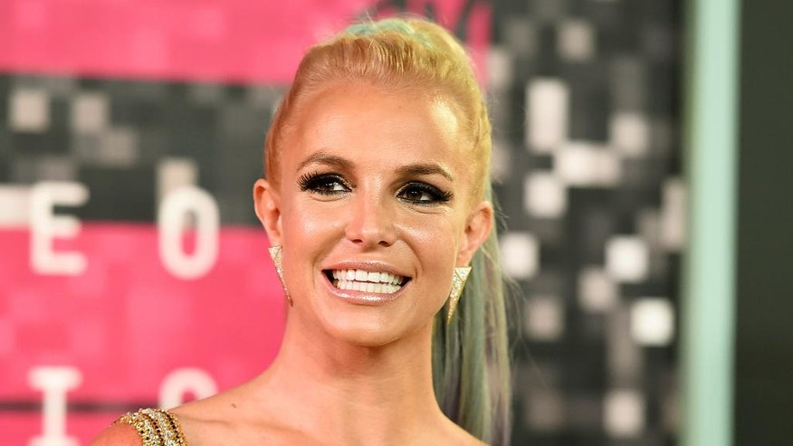 "FILE - In this Aug. 30, 2015, file photo, Britney Spears arrives at the MTV Video Music Awards in Los Angeles. GLAAD and Interscope Records have joined forces to release a song called ""Hands"" Wednesday, July 6, 2016, on iTunes featuring Spears, Jennifer Lopez and Mary J. Blige in tribute to the victims of the massacre in Orlando. (Photo by Jordan Strauss/Invision/AP, File)"