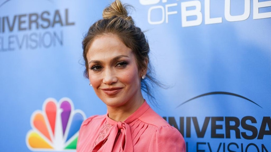 "FILE - In this June 9, 2016, file photo, Jennifer Lopez arrives at the ""Shades of Blue"" FYC Event at Saban Media Center in Los Angeles. GLAAD and Interscope Records have joined forces to release a song called ""Hands"" Wednesday, July 6, 2016, on iTunes featuring Britney Spears, Lopez and Mary J. Blige in tribute to the victims of the massacre in Orlando. (Photo by Rich Fury/Invision/AP, File)"