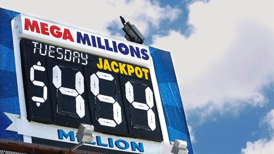 An electronic billboard displays the current Mega Millions jackpot, Tuesday, July 5, 2016, in Springfield, Ill. With slightly better odds than Powerball, it's rare that nearly four months passes without someone winning a Mega Millions jackpot, which has grown from $15 million prize to $454 million since the last winning drawing in March. (AP Photo/Seth Perlman)