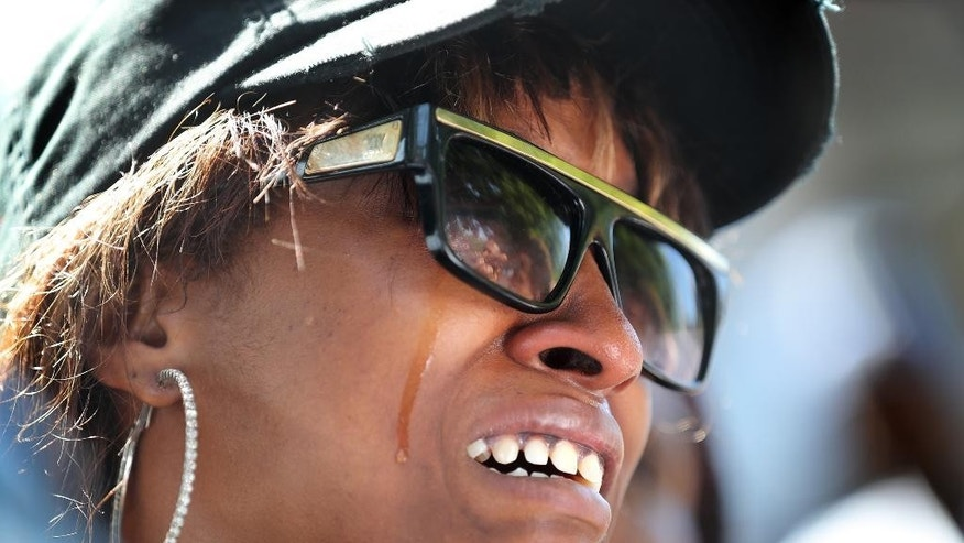 Diamond Reynolds, the girlfriend of Philando Castile, weeps during a press conference at the Governor'sResidence in St. Paul, Minn., Thursday, July 7, 2016. Philando Castile was shot in a car Wednesday night by police in the St. Paul suburb of Falcon Heights. Police have said the incident began when an officer initiated a traffic stop in suburban Falcon Heights but have not further explained what led to the shooting. (Leila Navidi/Star Tribune via AP)