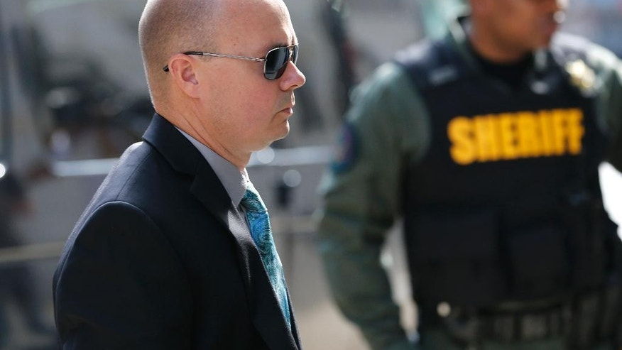 Lt. Brian Rice, one of the six members of the Baltimore Police Department charged in connection to the death of Freddie Gray, arrives at a courthouse for opening statements in his trial in Baltimore, Thursday, July 7, 2016. (AP Photo/Patrick Semansky)