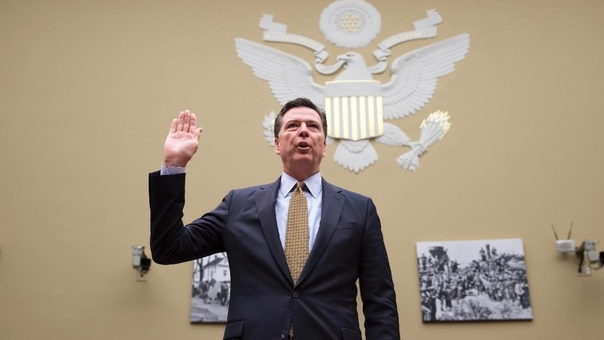 FBI Director James Comey is sworn in on Capitol Hill in Washington, Thursday, July 7, 2016, prior to testifying before the House House Oversight and Government Reform Committee hearing to explain his agency's recommendation to not prosecute  Democratic presidential candidate Hillary Clinton over her private email setup. (AP Photo/J. Scott Applewhite)