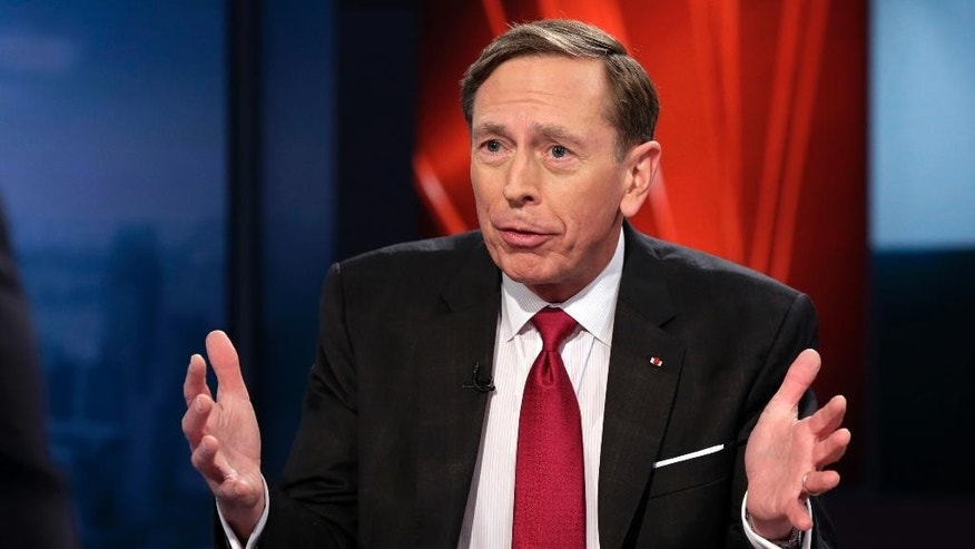 FILE - Int his March 17, 2016, file photo, former CIA Director and retired Gen. David Petraeus is interviewed on the Fox Business Network, in New York. The FBI's recommendation against criminal charges in the Hillary Clinton email matter drew immediate comparisons to last year's high-profile case in which the agency took the opposite position and pursued the prosecution of then-CIA Director Petraeus. (AP Photo/Richard Drew, File)