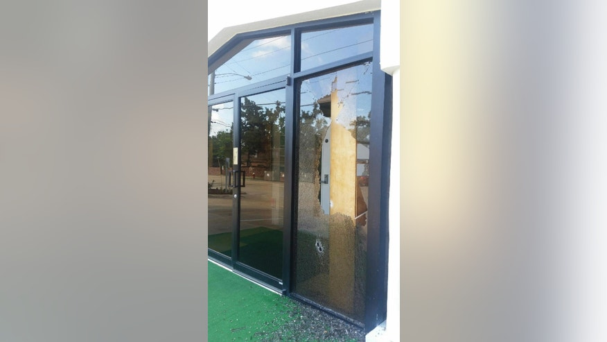 Bullet holes and broken glass are seen at the Islamic Community Center in College Station, Texas, Thursday, July 7, 2016. College Station police and the FBI are investigating after the building was hit by gunfire early Thursday. College Station police say nobody was hurt in the incident. (Timothy Hurst/College Station Eagle via AP) MANDATORY CREDIT
