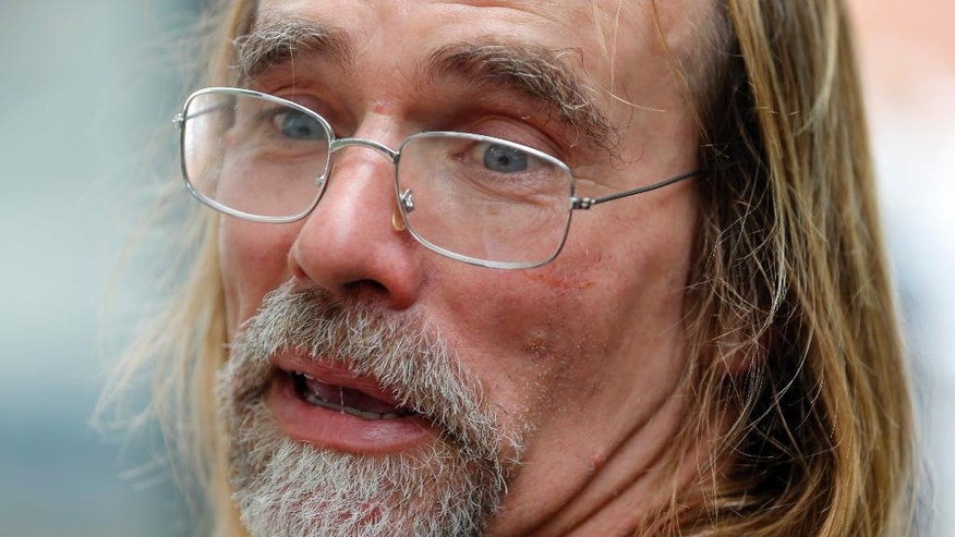In this Tuesday, July 5, 2016 photo, Patrick Lawson, father of 2-year-old Mirranda Grace Lawson, chokes up during an interview near the hospital where his daughter is being treated in Richmond, Va. Mirranda has been on life support since May 11 after choking on a piece of popcorn. (AP Photo/Steve Helber)