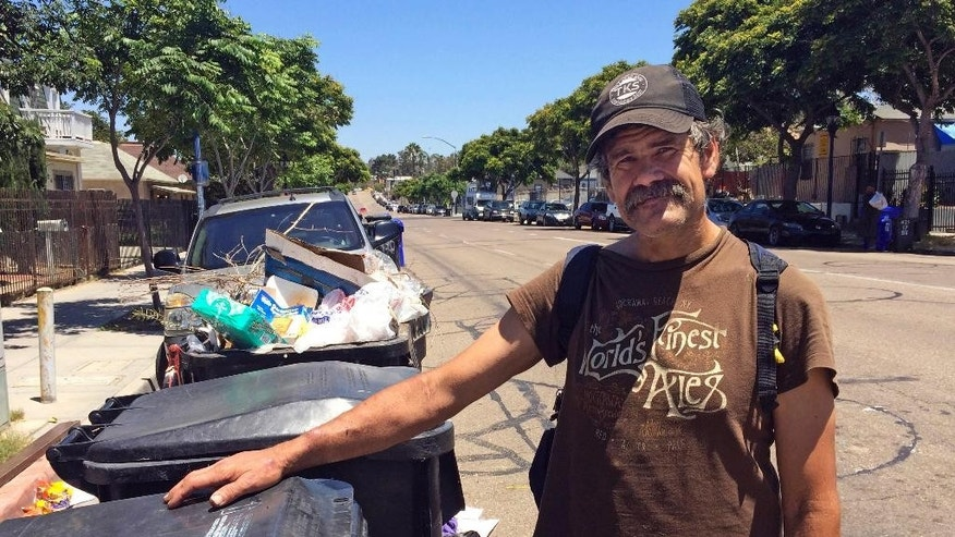 "Ron Shatto, 51, talks about a spate of attacks on homeless people after rummaging through trash bins on the outskirts of downtown San Diego Thursday, July 7, 2016. San Diego's homeless population was on edge Thursday after a spate of early-morning attacks on men who were sleeping alone and, in two cases, were set on fire. ""I don't want to wake up on fire,"" said Shatto, 51, who has been living in the streets since February 2015, most recently under a freeway bridge. (AP Photo/Elliot Spagat)"