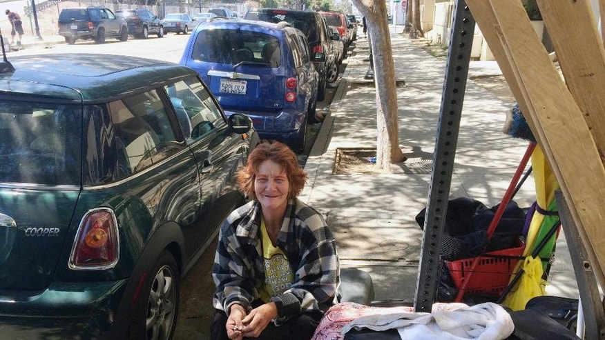 Adrienne Handley, a homeless woman, speaks about the attacks on the homeless from her encampment in downtown San Diego, Thursday, July 7, 2016. San Diego's homeless population was on edge Thursday after a spate of early-morning attacks on men who were sleeping alone and, in two cases, were set on fire. Handley had moved closer to other tents after the killings began. (AP Photo/Elliot Spagat)