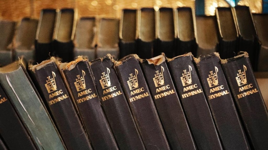 Hymnals sit on a shelf at Mother Bethel African Methodist Episcopal Church in Philadelphia, Wednesday, July 6, 2016. The church marks its 200th anniversary in the city where it was founded by a former slave. (AP Photo/Matt Rourke)