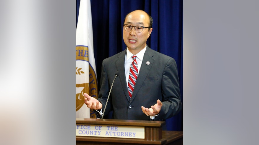 Ramsey County Attorney John Choi addresses the media Friday, July 8, 2016, in St. Paul, Minn., about procedures his office will follow in any possible prosecution of the St. Anthony police officer involved in the shooting death of Philando Castile  after a traffic stop Wednesday, July 6, in Falcon Heights. (AP Photo/Jim Mone)