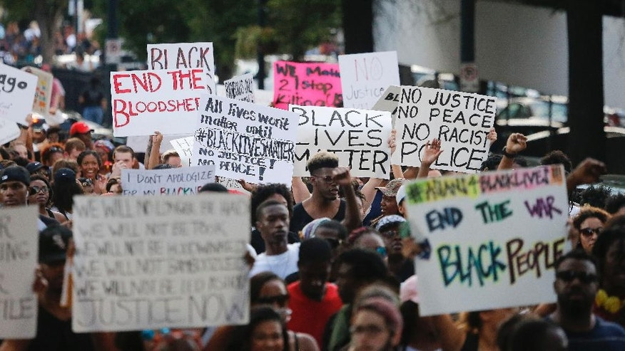 Demonstrators march through downtown Atlanta to protest the shootings of two black men by police officers, Friday, July 8, 2016. Thousands of people marched along the streets of downtown to protest the recent police shootings of African-Americans. Atlanta Police Chief George Turner and Atlanta Mayor Kasim Reed said earlier in the day that people have the right to protest this weekend but urged them to cooperate with law enforcement. (AP Photo/John Bazemore)