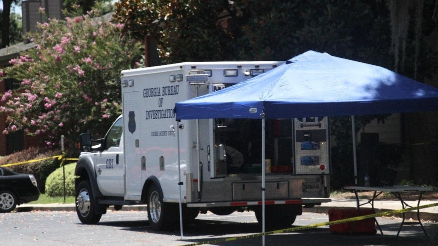 A Georgia Bureau of Investigation vehicles parks near the scene of an officer involved shooting, Friday, July 8, 2016, in Valdosta, Ga. A man who called 911 to report a car break-in Friday ambushed a south Georgia police officer dispatched to the scene, sparking a shootout in which both the officer and suspect were wounded, authorities said. Both are expected to survive. (Gabe Burns/The Daily Times via AP) MANDATORY CREDIT