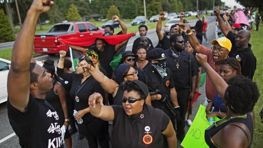Members of the New Black Panther Party march in front of the Baton Rouge Police Department headquarters in Baton Rouge, La., Saturday, July 9, 2016, in support of justice for Alton Sterling, who was killed by police Tuesday. (AP Photo/Max Becherer)