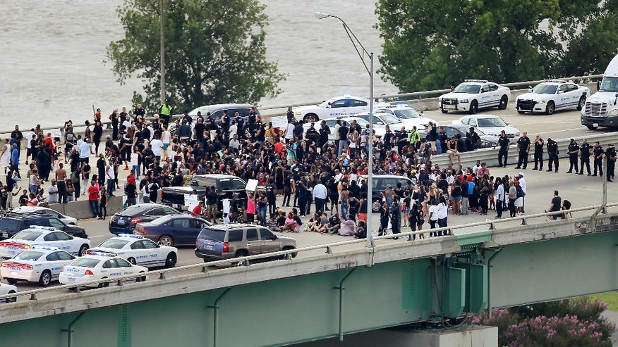 Black Lives Matter protesters gather on the Hernando Desoto Bridge in Memphis, Tenn., Sunday, July 10, 2016. Protesters angry over police killings of black people occupied the key bridge over the Mississippi River, blocking an interstate highway for hours. (Jim Weber/The Commercial Appeal via AP)