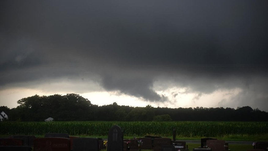 Clouds cover the sky as storms pass through the area north of Luxemburg, Minn., on Monday, July 11, 2016. At least two tornadoes, torrential rain and powerful winds damaged homes, forced the evacuation of a nursing home and flooded highways in north-central Minnesota. (Dave Schwarz/St. Cloud Times via AP)