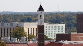 The campus clock tower of Purdue University can be seen from Ross-Aide Stadium during a NCAA Football game between the Minnesota Golden Gophers against the Purdue Boilermakers on Saturday, October 10, 2015 in West Lafayette, Indiana. The Minnesota Golden Gophers defeated the Purdue Boilermakers 41-13. (Scott Boehm via AP)