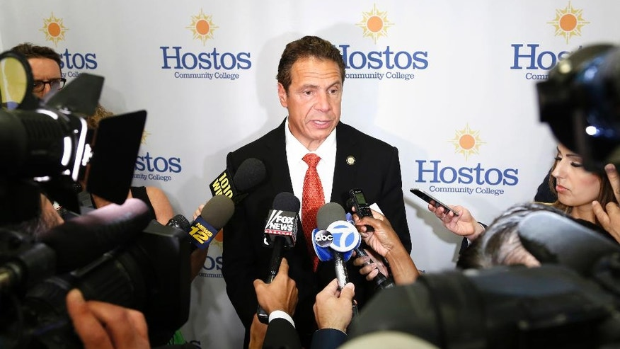 New York Governor Andrew Cuomo speaks to reporters after an announcement in New York, Wednesday, July 13, 2016. Cuomo answered some questions about an immigration lottery, where the state will cover the application fee for about 2000 people seeking to become citizens. (AP Photo/Seth Wenig)