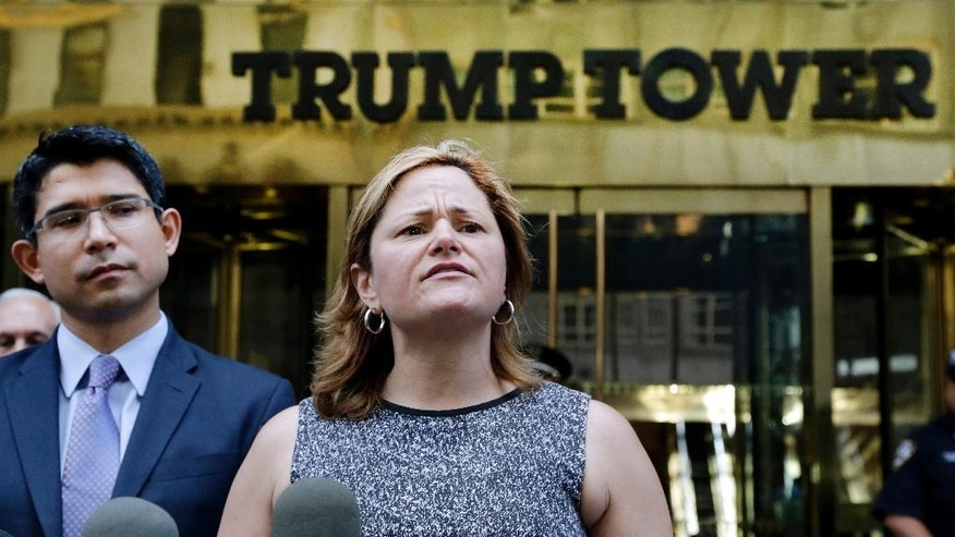 FILE - In this June 6, 2016 file photo, New York City Council Speaker Melissa Mark-Viverito, with City Councilman Carlos Menchaca, left, speaks at a news conference outside Trump Tower in New York.  Donald Trump's lightning-rod proposals to deport illegal immigrants and temporarily ban Muslims from entering the United States could cost New York state more than $800 million and New York City more 340,000 jobs, according to an analysis by Mark-Viverito.  She is expected to unveil the findings in a speech Wednesday, July 13, 2016.    (AP Photo/Mark Lennihan, file)