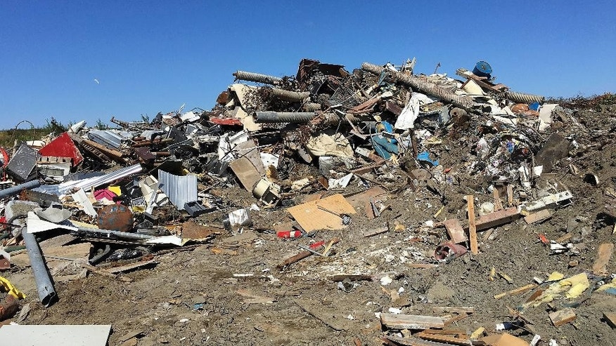 This Tuesday, July 12, 2016, photo provided by the City of Bethel shows junk at the city's landfill in Bethel, Alaska. A decades-long tradition at one of Alaska's largest rural hubs has come to an end with a ban on the popular local practice of scavenging at the Bethel landfill. The recent clampdown in Bethel comes amid concerns that the dangerous conditions at the dump were creating a liability for the community. (Ann Capela/City of Bethel via AP)