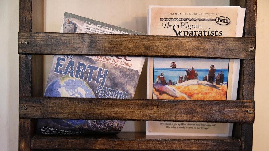 A magazine rack displays publications by The Twelve Tribes sect at the Blue Blinds Bakery, Wednesday, July 13, 2016, in Plymouth, Mass. The bakery is owned by a Christian sect, The Twelve Tribes. About three weeks ago, messages began to appear on the bakery's Facebook page accusing the sect of child abuse and racism. The group denies the allegations. (AP Photo/Charles Krupa)