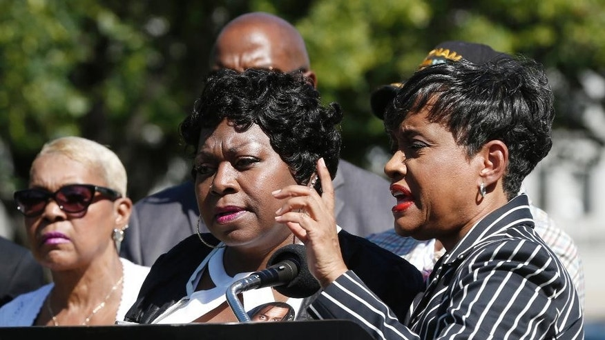 TV Judge Glenda Hatchett, right, speaks as Valerie Castile, the mother of Philando Castile, listens during a news conference on the State Capitol grounds Tuesday, July 12, 2016, in St. Paul, Minn. Hatchett is representing the Castile family in the shooting death by police of Philando Castile last week in Falcon Heights, Minn. after a traffic stop by St. Anthony police. (AP Photo/Jim Mone)