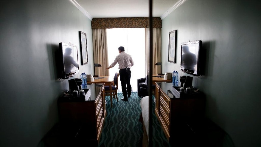 """ECONOMY/INCOME INEQUALITY: Hotel owner Elvin Lai inspects a room as he makes his rounds at his hotel in San Diego on Friday, June 10, 2016. A fourth-generation hotelier, Lai has worked his way through nearly every job at the small beach hotel. """"Raising the minimum wage doesn't necessarily raise their ability to live,"""" he said. """"It is uplifting them through certain skills and increasing their ability to earn while keeping minimum wage at a low. What does a minimum wage increase do? It raises everything. As minimum wage is going up, everything goes up. I'll have to raise my food prices on a week to week basis, as my vendors, and their vendors, increase their prices."""" (AP Photo/Gregory Bull)"""