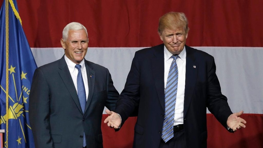 FILE - In this July 12, 2016 file photo, Indiana Gov. Mike Pence joins Republican presidential candidate Donald Trump at a rally in Westfield, Ind. Trump has chosen Indiana Pence as his running mate, adding political experience and conservative bona fides to his Republican presidential ticket. Trump announced his decision on Twitter Friday morning, capping a frenzied 24 hours of speculation about his choice. (AP Photo/Michael Conroy, File)