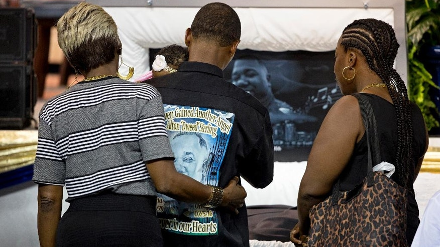 Mourners visit the body of Alton Sterling at the F.G. Clark Activity Center in Baton Rouge, La., Friday, July 15, 2016. Sterling was shot July 5 outside a Baton Rouge convenience store in an encounter with police that was caught on video.  (AP Photo/Max Becherer, Pool)