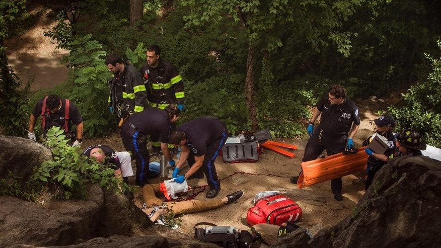 FILE - In this July 3, 2016 file photo, Connor Golden, a University of Miami student from Fairfax, Virginia, center bottom, bleeds from his injured leg as he is helped by emergency responders after police said he stepped on a plastic bag containing a homemade explosive and lost his lower left leg and foot. Police said Thursday, July 14  the substances found in their investigation of the explosive device are legally available for sale in hardware stores and can be used with other products to develop homemade explosive devices. Investigators say they believe the explosive was made by someone experimenting with commercially available products. (AP Photo/Andres Kudacki, File)