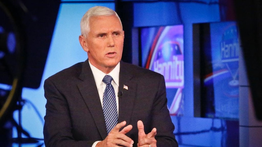 Indiana Gov. Mike Pence speaks during an interview with FOX News Channel's Sean Hannity after Donald Trump selected him for running mate on the Republican presidential ticket, Friday July 15, 2016, in New York. Pence's conservative track record on immigration dates to his earliest days in the House of Representatives and echoes the hard-line stance of his presumptive running mate on the Republican presidential ticket, Donald Trump. (AP Photo/Bebeto Matthews)