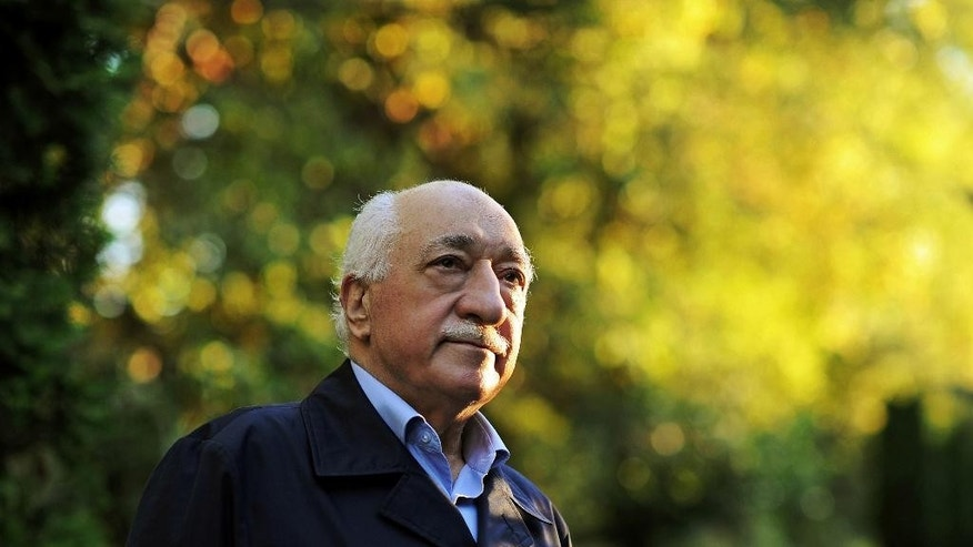 "FILE - In this Sept. 24, 2013 file photo, Turkish Islamic preacher Fethullah Gulen is pictured at his residence in Saylorsburg, Pa. A lawyer for the Turkish government, Robert Amsterdam, said that ""there are indications of direct involvement"" in the Friday, July 15, 2016, coup attempt of Fethullah Gulen, a Muslim cleric who is living in exile in Pennsylvania. He said he and his firm ""have attempted repeatedly to warn the U.S. government of the threat posed"" by Gulen and his movement. (AP Photo/Selahattin Sevi, File)"