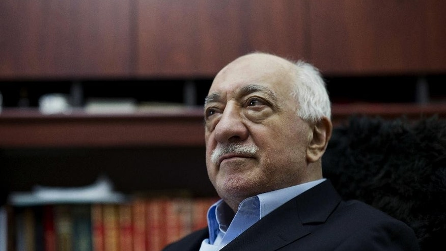 "FILE - In this March 15, 2014 file photo, Turkish Muslim cleric Fethullah Gulen, sits at his residence in Saylorsburg, Pa. A lawyer for the Turkish government, Robert Amsterdam, said that ""there are indications of direct involvement"" in the Friday, July 15, 2016, coup attempt of Fethullah Gulen, a Muslim cleric who is living in exile in Pennsylvania. (AP Photo/Selahattin Sevi, File)"