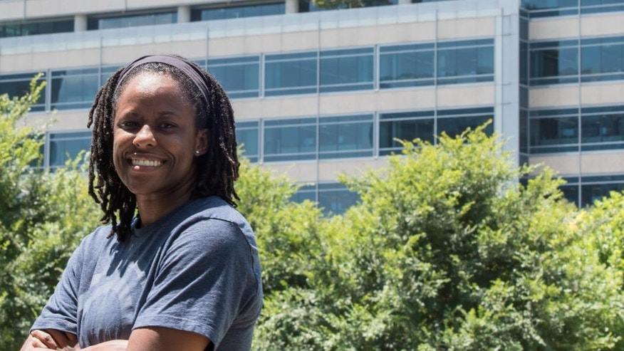 Chelsea Whitaker, former point guard from Baylor University and now a detective with the Dallas Police Department, poses for a portrait on Wednesday, July 13, 2016, in Dallas. In the aftermath of the deadly attack on Dallas officers, the city's police chief issued an appeal to blacks: If you want to change law enforcement, join us. Apply to become a cop. Whitaker heeded that call nearly a decade ago, long before the fatal police shootings in Ferguson and North Charleston and Baton Rouge and Falcon Ridge, Minnesota.  (AP Photo/Lisa Marie Pane)
