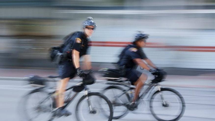 Police officers patrol downtown on Sunday, July 17, 2016, in Cleveland, in preparation for the Republican National Convention that starts Monday. (AP Photo/Patrick Semansky)