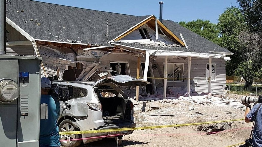 This July 14, 2016 photo provided by Dennis Sanders shows a house in Panaca, Nev. after it was destroyed by explosives. Arizona police announced Friday the discovery of improvised bombs and several pounds of explosives found in Kingman, Ariz., in the home and car of a man who traveled to the quiet Nevada town and set off bombs that killed him and showered the community with shrapnel and debris. (Dennis Sanders via AP)