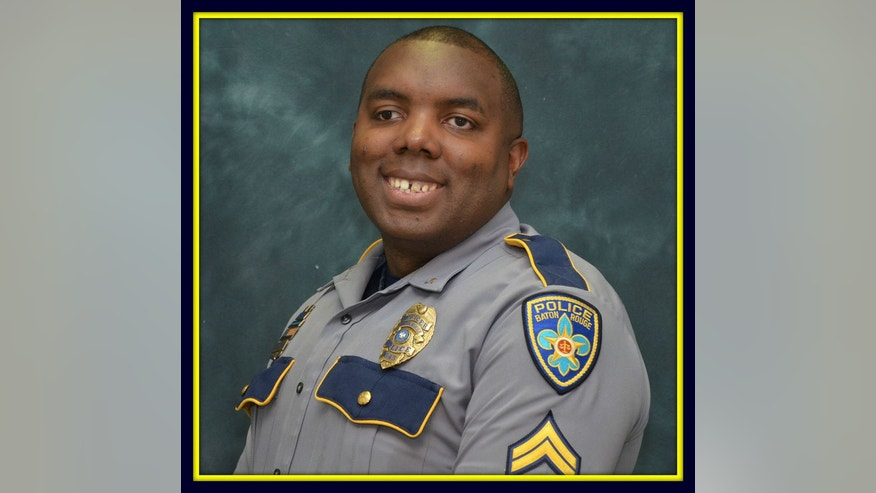 This undated photo made available by the Baton Rouge Police Dept. shows officer Montrell Jackson. Jackson, 32, has been identified as one of the police officers killed in a shooting early Sunday, July 17, 2016, in Baton Rouge, La. (Baton Rouge Police Dept. via AP)