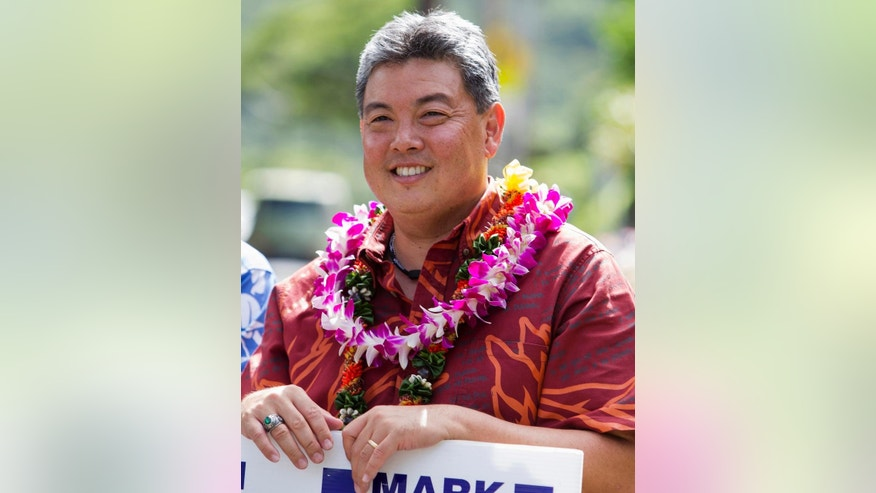 FILE- This Nov. 4, 2014 file photo shows then-Hawaii Democratic Congressional candidate, State Rep Mark Takai in Honolulu. Takai died at his home on Wednesday, July 20, 2016, after battling cancer. (AP Photo/Marco Garcia, File)