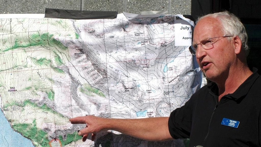 Alaska fire incident commander Tom Kurth points toward a map while speaking about wildfires at a news conference in Anchorage, Alaska, Wednesday, July 20, 2016. A wildfire burning just south of Alaska's largest city was human caused, fire officials said Wednesday. (AP Photo/Rachel D'Oro)
