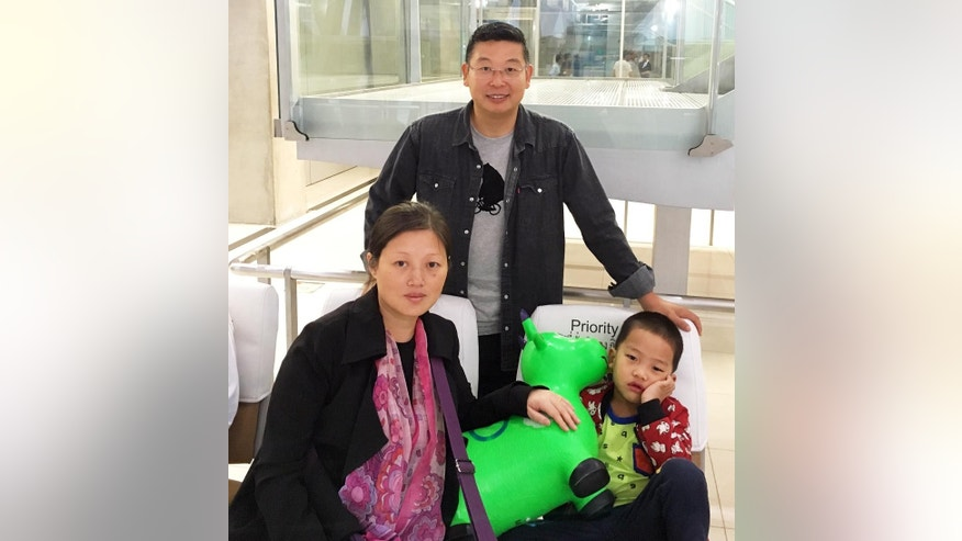 This Tuesday, July 19, 2016 photo provided by Initiatives for China/Citizen Power for China shows Liu Xiaodong, 40, wife of prominent Chinese dissident Zhao Changqing, her 4-year-old son, and Dr. Yang Jianli, president of Initiatives for China/Citizen Power for China, after their arrival on a flight from Bangkok at San Francisco International Airport in San Francisco, Calif. Others are unidentified. Xiaodong and her son plan to live in the Bay Area for about a year as refugees. Changqing has been one of China's leading human rights and democracy defenders since the 1989 Tiananmen Students Movement. (Initiatives for China/Citizen Power for China via AP)