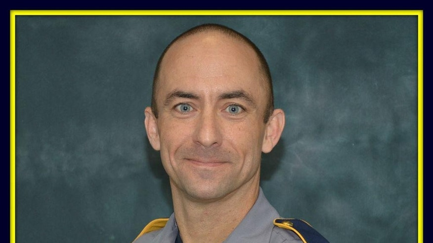 FILE - This undated file photo made available by the Baton Rouge Police Dept. shows police officer Matthew Gerald. Gerald, 41, was killed by a gunman in Baton Rouge, LA., Sunday, July 17, 2016. Back-to-back attacks on police in Texas and Louisiana by former military men have touched a nerve among veterans who traditionally share a close bond with law enforcement. Gerald, was a former Marine who enlisted in the Army after the Sept. 11 attacks and also served in Iraq in 2009. (Baton Rouge Police Dept. via AP, File)